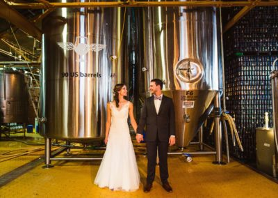 Couple in front of the fermentors at Wild Heaven Avondale for Micro Wedding Packages